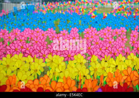 Field full of colorful pinwheels at FLORIA event held in Putrajaya, Malaysia. - Stock Photo