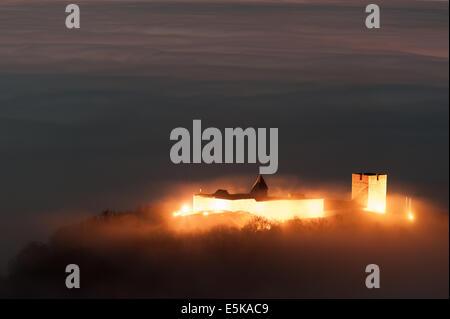 Medvedgrad castle shining above the city of Zagreb, in fog. - Stock Photo