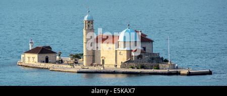 Tourists visiting Our Lady of the Rocks on an artificial island in the Bay of Kotor Montenegro Europe - Stock Photo