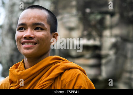 Buddhist monks in the inner part of Bayon temple. Angkor Thom. Angkor Thom was built as a square, the sides of which - Stock Photo