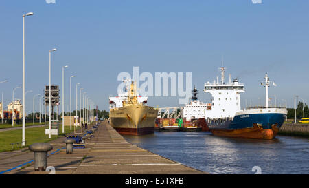 Ships waiting in a lock sluice to leave the Port of Rotterdam. - Stock Photo