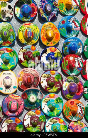 Small china sombreros  tourist stall Chichen Itza Yucatan Mexico - Stock Photo
