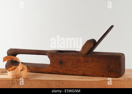 Old planer with wood chips - Stock Photo