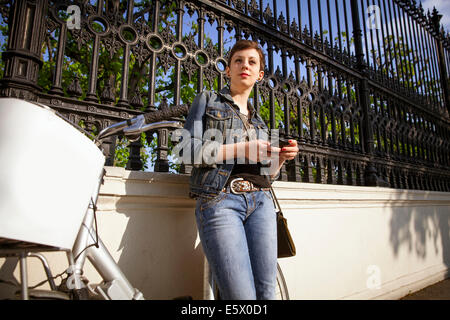 Young adult woman using mobile phone - Stock Photo