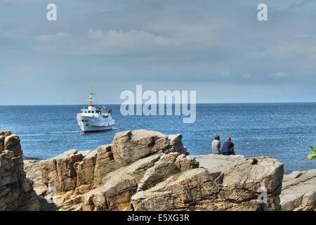 Denmark, Bornholm Island Pictures taken between 1st and 5th August 2014.  Pictured: People sit on the rocks in the - Stock Photo
