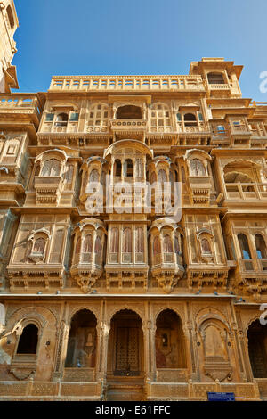 rich ornated facade of Patwon Ki Haveli, Jaisalmer, Rajasthan, India - Stock Photo