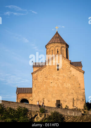 Metekhi church and in the old town of Tbilisi, the capital of Georgia, at sunset. - Stock Photo