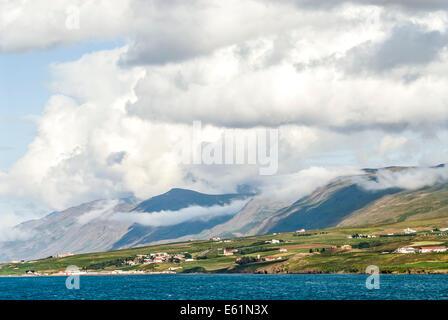Remote village in a Mountain landscape in Northern Iceland near Akureyri. - Stock Photo