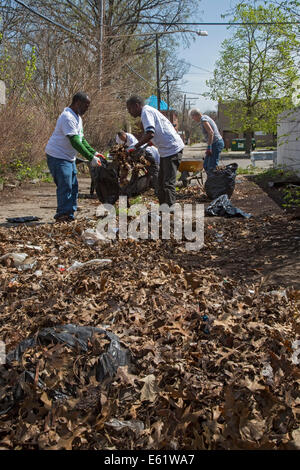 Detroit, Michigan - Members of the Three Mile Drive Block Club clean up trash that had been dumped on a vacant lot. - Stock Photo
