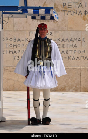 Evzone soldier with traditional uniform standing guard at the Tomb of the Unknown Soldier in Athens, Greece. - Stock Photo