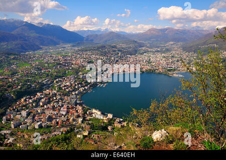 View of Lugano on Lake Lugano and the Alps, Monte San Salvatore mountain, Lugano, Canton of Ticino, Switzerland - Stock Photo