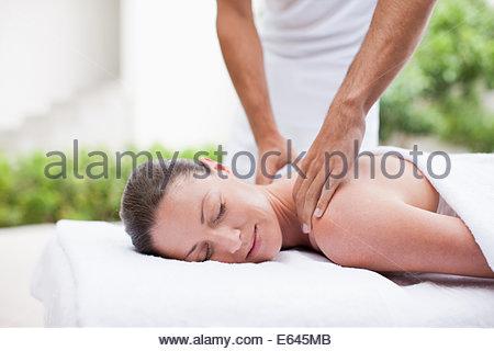 Woman receiving massage - Stock Photo