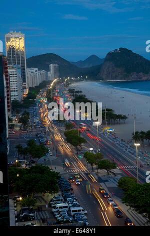 Copacabana Beach, and Avenue Atlantica at night, Copacabana, Rio de Janeiro, Brazil - Stock Photo