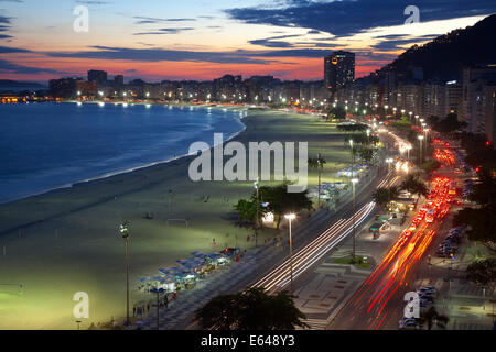 Copacabana Beach, and Avenue Atlantica at night, Copacabana, Rio de Janeiro, Brazil - Stock Photo