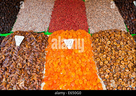 Dried apricots, dates, figs and nuts, on sale at a market stall in Djemaa el Fna square, Marrakech, Morocco - Stock Photo