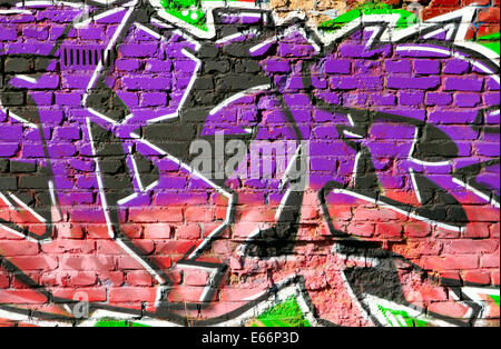 Brick wall with graffiti close-up, may be used as background - Stock Photo