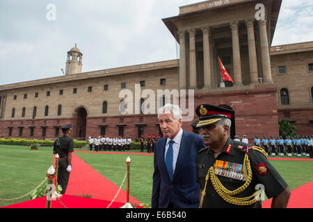 U.S. Secretary of Defense Chuck Hagel, left, is honored during an Honor Guard ceremony in New Delhi Aug. 8, 2014 - Stock Photo