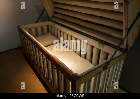 19th century padded cage bed for epileptics in the Dr Guislain Museum about the history of psychiatry, Ghent, Belgium - Stock Photo