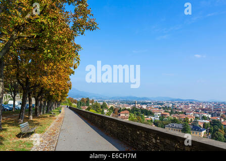 View over Bergamo Bassa from the path along the walls around Bergamo Alta, Lombardy, Italy - Stock Photo