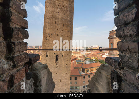 Bologna Leaning, tilting Garisenda Tower seen from the Asinelli Tower. - Stock Photo