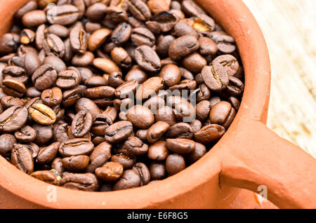 Roasted coffee beans in a cup - Stock Photo