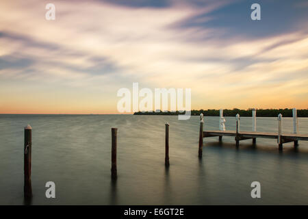Sunrise on Captiva Pier, Florida, USA - Stock Photo