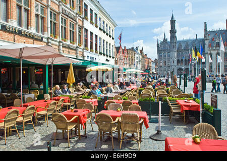 An open air restaurant and cafe in central Bruges in Belgium - Stock Photo