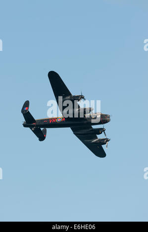 Dawlish, UK. 23rd Aug, 2014. Battle of Britain Memorial Flight with the Avro Lancaster from Canadian Warplane Heritage - Stock Photo
