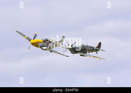 Dunsfold, UK. 23rd Aug, 2014. Dunsfold aerodrome in Surrey holds an annual motor and airshow over the August Bank - Stock Photo
