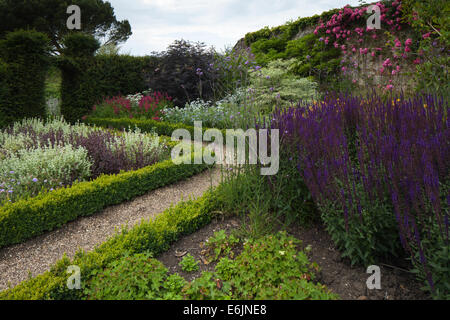 A colourful section of walled garden within the grounds of Rockingham Castle near Corby in Northamtponshire, England - Stock Photo