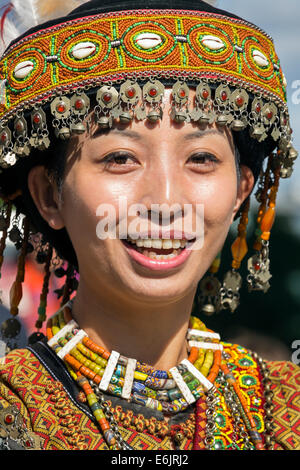 Female member of the Taiwan Contemporary Dance group, in the national costume, doing a street performance in Edinburgh - Stock Photo