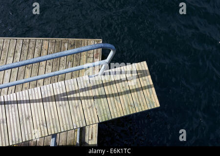 Outdoor swimming pool diving board - Stock Photo