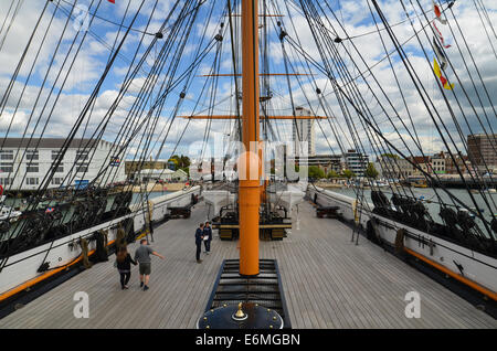 Looking forward along the deck on HMS Warrior in Portsmouth Historic Dockyard. - Stock Photo