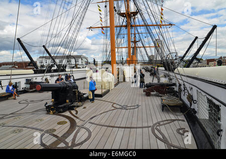 Looking forward across the deck from the aft of HMS Warrior in Portsmouth Historic Dockyard. - Stock Photo