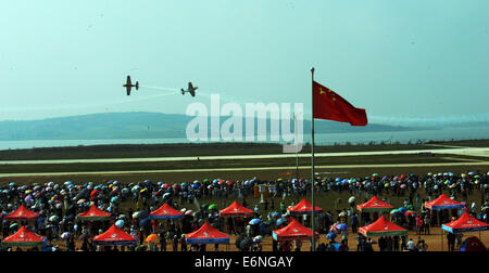 (140828) -- FAKU, Aug. 28, 2014 (Xinhua) -- Two planes of the Red Bull Aerobatic Team fly in formation in an air - Stock Photo