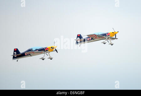 (140828) -- FAKU, Aug. 28, 2014 (Xinhua) -- Two planes of the Red Bull Aerobatic Team fly in formation in a training - Stock Photo