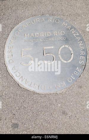 Distance plaque in Madrid Rio park, Madrid, Spain. - Stock Photo