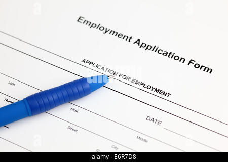 Employment application form and ballpoint pen - Stock Photo