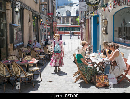 People sitting at restaurant tables old town Le Mans, France, Europe - Stock Photo