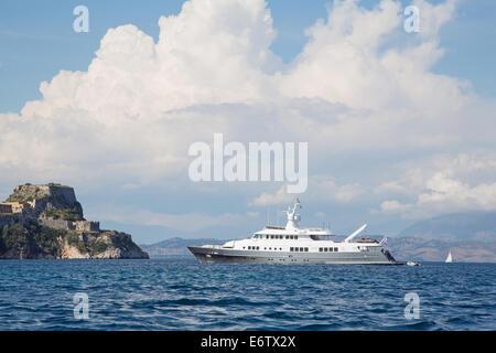 Landscape: Luxury large super or mega motor yacht on anchor in corfu - greece. - Stock Photo
