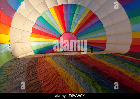 Brightly coloured hot air balloon from the inside, about to be filled with air before take-off, Sport - Stock Photo