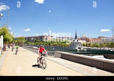 Cyclists on the Madrid Rio Park - Stock Photo