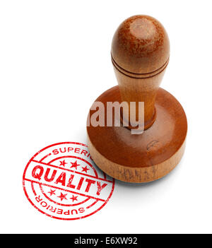 Red superior quality stamp with wooden stamper isolated on white background. - Stock Photo