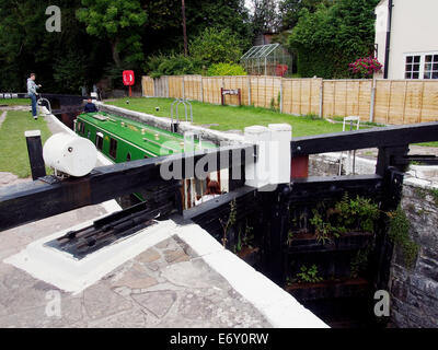 The Monmouthshire & Brecon Canal (Mon & Brec) -  a narrow boat in Brynich Lock as the lock empties to allow passage - Stock Photo