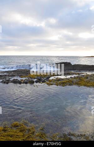 Waves Crash Over the Rocks in Laguna Beach, California - Stock Photo