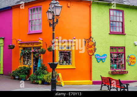 Brightly coloured shops in Kinsale, County Cork, Ireland. - Stock Photo