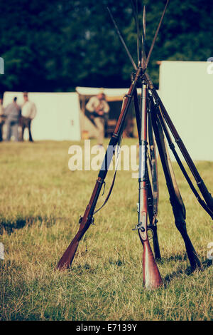 American Civil War Confederate soldiers rifles in camp at a historical re-enactment. Detling, Kent, UK. - Stock Photo