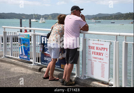 Tourists on the pier at Paihia North island New Zealand - Stock Photo