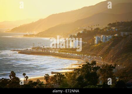 Late afternoon sunset light on Malibu, California, and the Pacific Coast Highway - Stock Photo