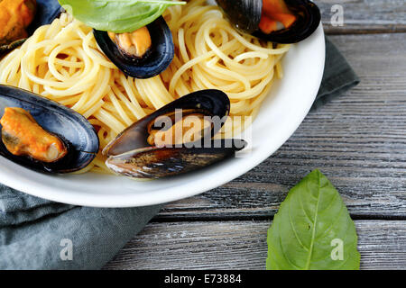 Spaghetti with mussels on a plate. Seafood - Stock Photo